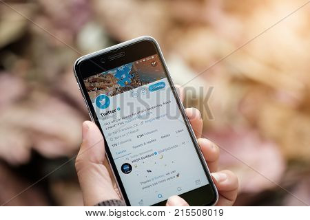 CHIANGMAI THAILAND - NOV 10 2017 : Man hand holding iPhone 6s using Twitter application Now Twitter's expansion to 280 characters from 140 characters