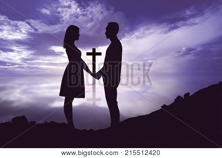 Portrait Of Romantic Couple Holding Hands And Looking At Each Other