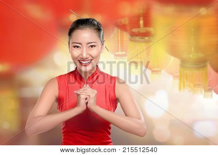 Young Chinese Woman In Cheongsam Clothes With Red Lanterns