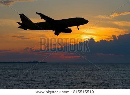 Night Landscape. Contour of Passenger plane over night sea