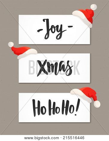 Christmas banners with holiday greeting quotes and red Santa hats. Joy, Xmas and Ho-ho-ho hand drawn text. Great for Christmas and New year flyers, posters, gift tags and labels, website headers.