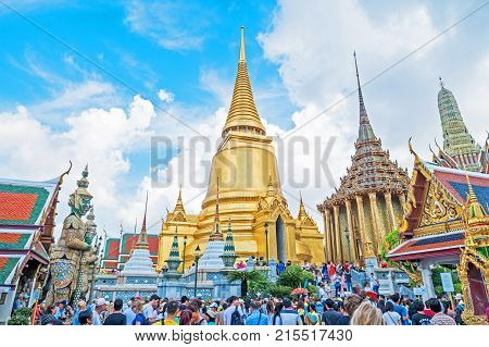 BANGKOK,THAILAND - JANUARY 9 : Tourists visiting Wat Phra Kaew,  the Temple of the Emerald Buddha, in Bangkok Thailand. Wat Phra Kaew, located in the Grand Palace, is one of the most popular tourists destination in Thailand.