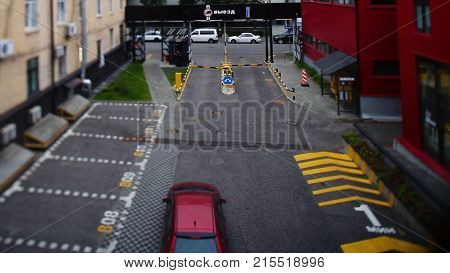 Car leaves the road under the barrier. Car left the Parking for the meeting is a road barrier.
