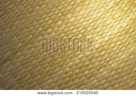 Background texture of the mat, made from dry papyrus,  ancient bed sheet in Thailand, close up image.