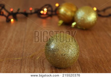 Golden Christmas decorations. Golden balls and tinsel on the tree. Christmas toys. Gold jewelry with sequins. New year's tradition. To decorate the Christmas tree. Decorate the Christmas tree balls. The festive mood, the Christmas spirit