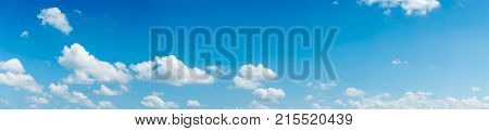 clear blue sky with plain white cloud with space for text background. The vast blue sky and clouds. blue sky background with tiny clouds nature. panorama