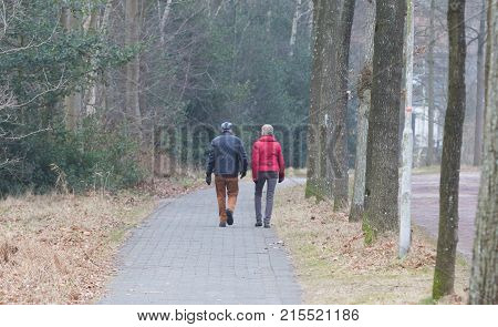 Couple Walking On A Street In The Netherlands