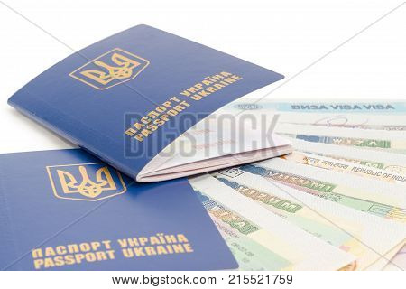 Two Ukrainian passports on a background of several travel visas closeup on a white background