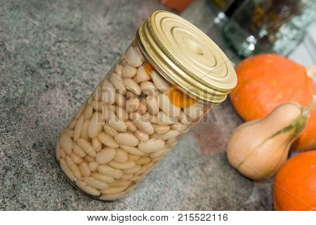 a jar of delicious white beans in the kitchen
