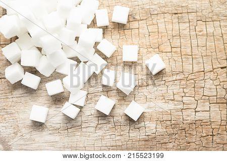 White cube sugar on white granulated sugar