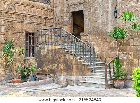 Cairo, Egypt - November 25, 2017: Courtyard of Prince Tax palace with staircase and entrance leading to the first floor located in Old Cairo