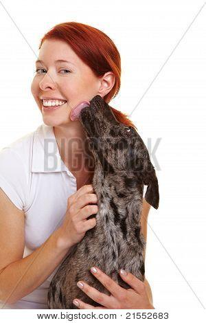 Dog Licking Woman's Cheek
