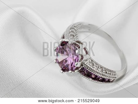 Jewelery ring on white cloth background , copy-space