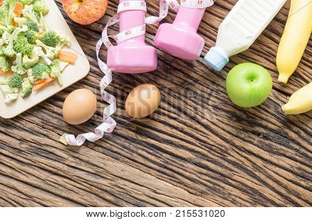 Fitness And Healthy Active Lifestyle Background Concept. Dumbbell, Sneakers,  Milk Bottle, Apples, E