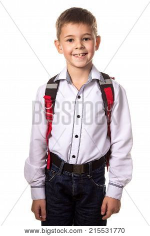 Smiling school boy with backpack, ready to school on white background.