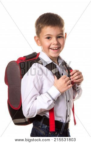 Cheerful school boy with backpack, ready to school on white background.