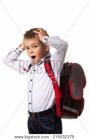Starting going to the school. Boring, yawning school boy standing with full backpack on the white background.