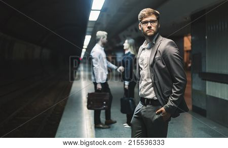 Business people waiting for underground subway transportation