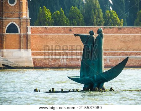 VENICE, ITALY - SEPTEMBER 6, 2013: Monument to Dante and Virgil in the Venice lagoon. Venice, Italy