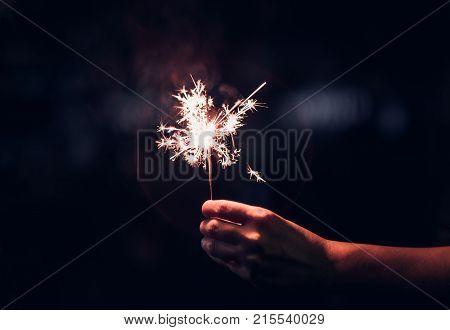 Hand Holding Burning Sparkler Blast On A Black Background At Night,holiday Celebration Event Party,d