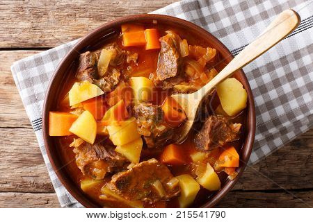 Spicy Stew Estofado With Beef And Vegetables In A Bowl Close-up. Horizontal Top View