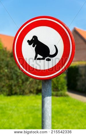 Traffic sign prohibited to let the dog here