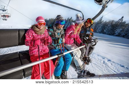 Family going on ski terrain to skiing with ski lift