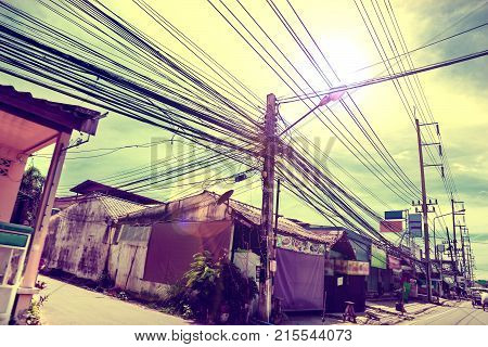 Phuket street.Power lines again the sky.Messy electrical cables.Sunset scenery.Thailand.Travel to Asia.