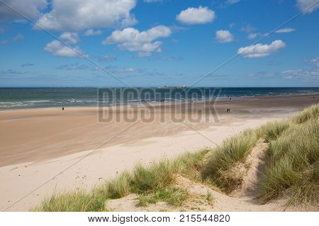 Northumberland beach and coast at Bamburgh north east England UK with view to the Farne islands tourist attraction