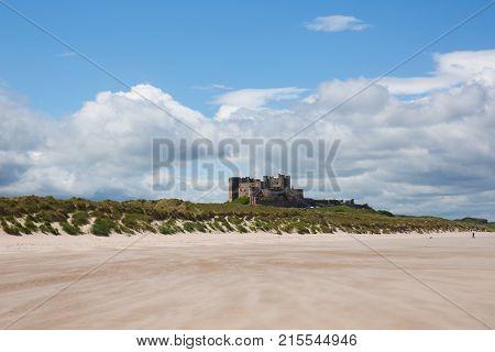Bamburgh Castle Northumberland north east England UK with white sandy beach