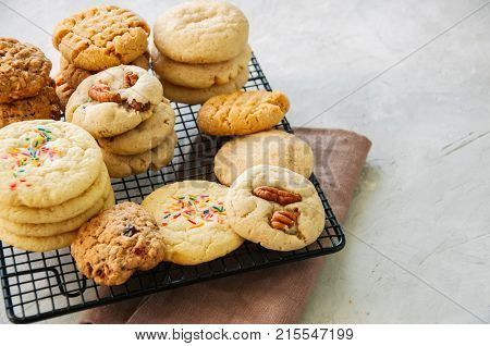 Set Of Festive Cookies On A Wire Rack. Peanut Butter, Pecan, Oatmeal, Shortbread, Snickerdoodle Roun