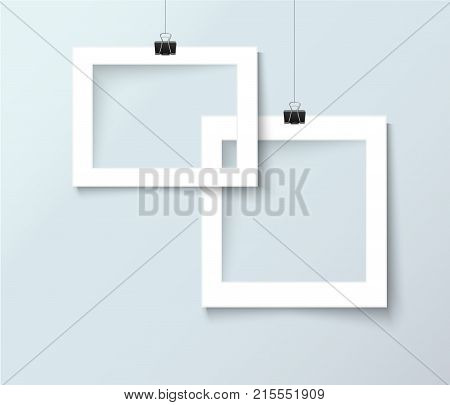 Blank photo frame hanging on paper clip. Retro vintage style like polaroid with empty place for your text or photo. Realistic vector design template isolated on light background.