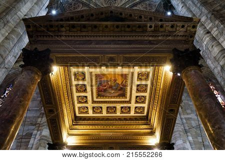 Milan, Italy - May 16, 2017: Interior of the Milan Cathedral (Duomo di Milano). Detail of Baptistery. Milan Duomo is the largest church in Italy and the fifth largest in the world.