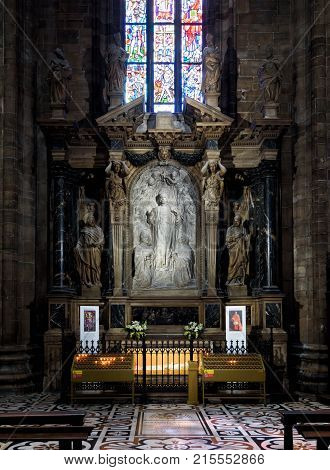 Milan, Italy - May 16, 2017: Interior of the Milan Cathedral (Duomo di Milano). Tomb of cardinal Caprara. Milan Duomo is the largest church in Italy and the fifth largest in the world.