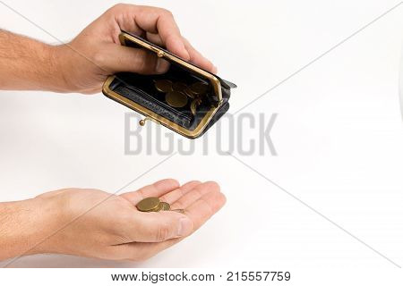 Man Holding An Very Old Wallet Over An Of Hand With Coins . The Concept Of Poverty. The Place To Adv