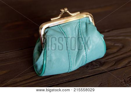 Purse For Coins. A Leather Purse . Closed Wallet On Wooden Background