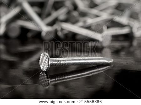 pile of metal nails on a white background construction equipment steel