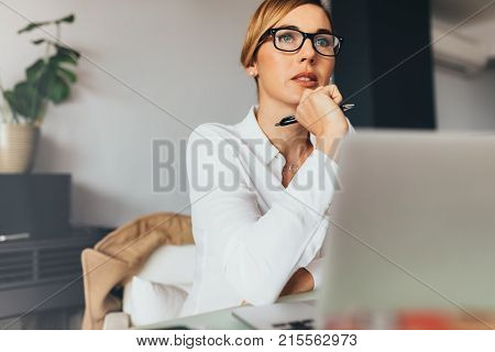 Woman At Work In Office