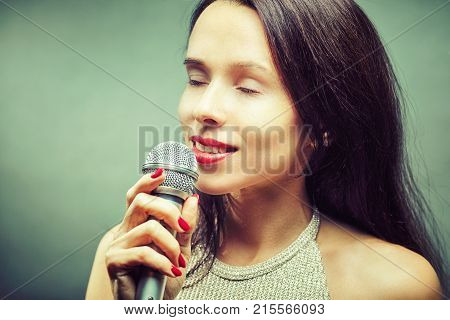 Rock star. Sexy Girl singing with mic