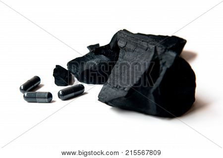 Charcoal And Activated Charcoal Capsules Isolate On White Background
