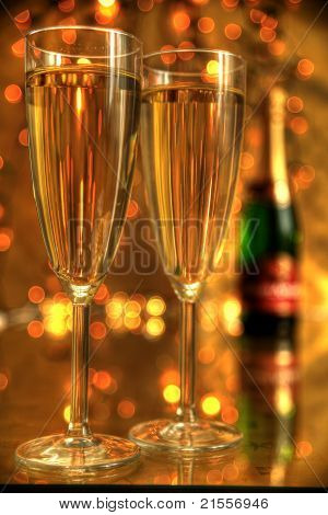 Champagne in glasses and gifts