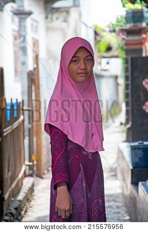 LOMBOK, INDONESIA - DECEMBER 30, 2016: muslim girl in the streets in Lombok, Indonesia on the 30th of december 2016