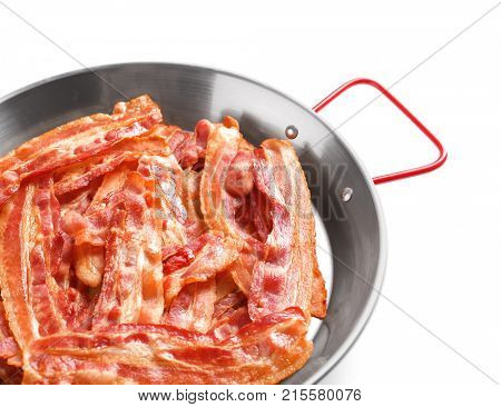 Frying pan with cooked bacon rashers on white background