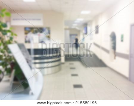 Abstract blurred background with business centre. Unfocused office place Blur background soft lightning. Blurry working place. Bokeh background.
