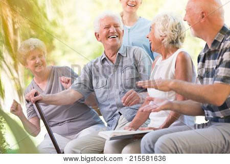 Senior People Welcoming Friend