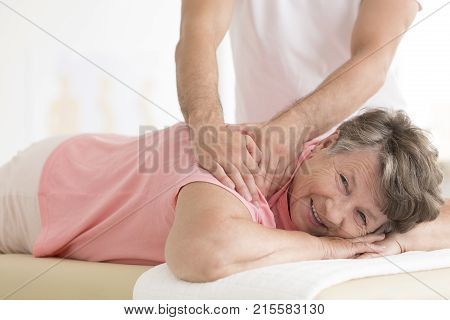 Personal Masseur Massaging Senior Woman