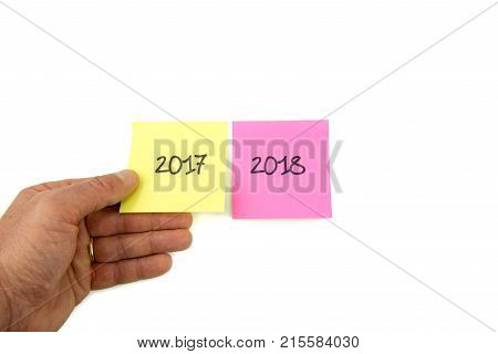 Concept for turn of the year three post it with three years : 2017 2018