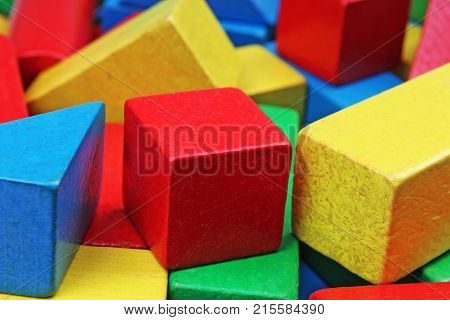 Wooden toy block background. Red, Blue, Yellow Green Wooden toy blocks on white background. Wood block texture pattern. Rainbow colors.