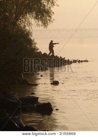 Fisher Near Sunset River