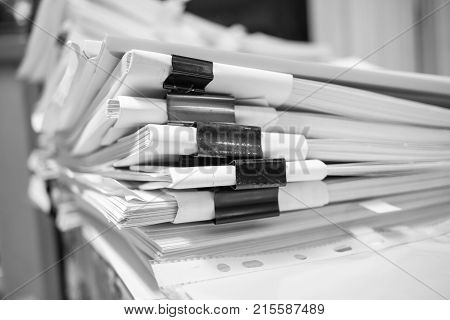 Paper stack Pile of unfinished documents on office desk related to business functions. Stack of business papers for Annual Report files Document is writtendrawnpresented. Business offices concept.